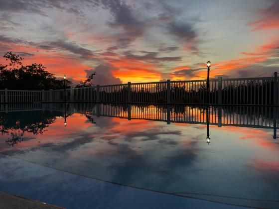 The sunset over the pool area after a rain created an awesome reflection!