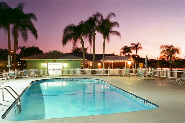 The sun setting over Clearwater Travel Resorts Sparkling Pool.