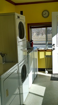 Bright laundromat with books/magazines to share