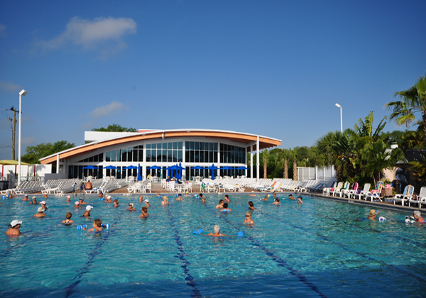 Olympic-size heated pool with large pool deck and children's splash area