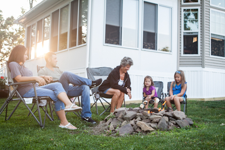 Family relaxing around the campfire at the Double G RV Park