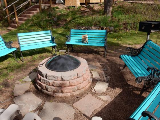 Have fun by the fire ring at Bristlecone Lodge in Woodland Park!