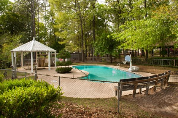 our second pool is a peaceful place to relax under the trees at Sunburst RV Resort in Milton Florida