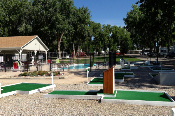 Mini golf and swimming make for great entertainment at Loveland RV Resort!