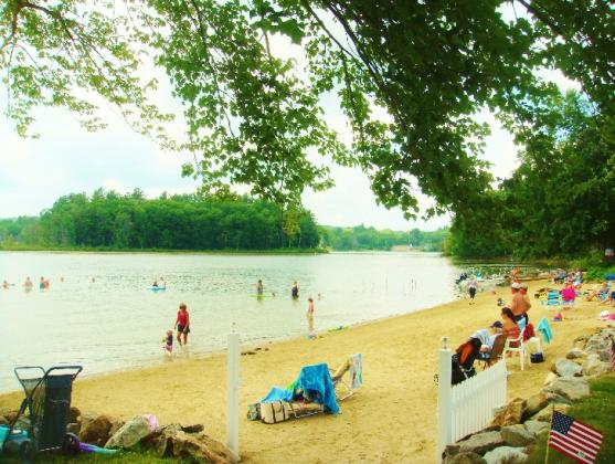 Large, groomed swimming beach with safety entrance gate